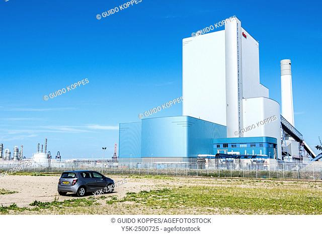 Maasvlakte, Rotterdam, Netherlands. The newly build and coal fired E.ON power plant on the 2e Maasvlakte in Rotterdam Harbor against a clean, blue sky
