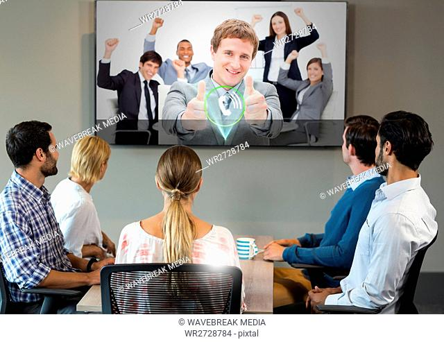 Businesspeople having video calling on television
