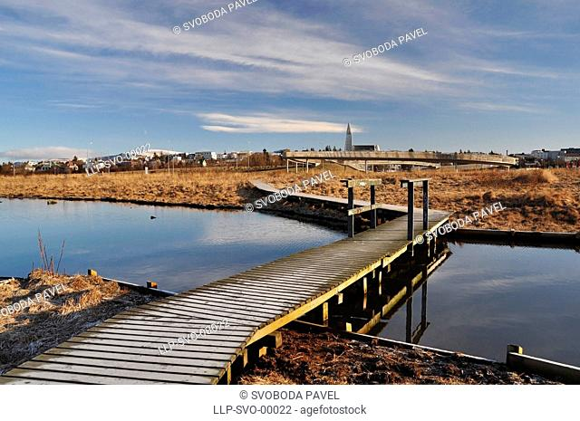 Beautiful view to Reykjavik downtown with wooden foot bridge, Iceland