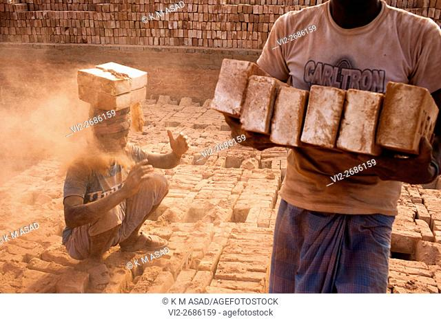 A labourer working in a brickfield covered with thick dust in Dhaka Bangladesh, December 10, 2015. In this brickfield burning coal causes tremendous production...
