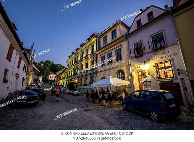 Tenement houses at Strada Scolii (School Street) in Historic Centre of Sighisoara city, Transylvania region in Romania