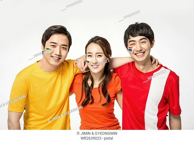 Portrait of young smiling people with their arms on each other's shoulders