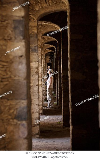 A tourist walks inside the multiple arches inside the Santa Brigida, an abandoned gold mine, in Mineral de Pozos, San Luis de la Paz