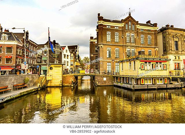 Bridges Reflection Canal Amsterdam Holland Netherlands. Canals in Amsterdam create beautiful abstract reflections