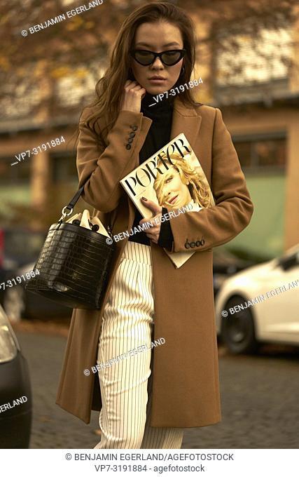 Woman walking in city, Munich, Bavaria, Germany