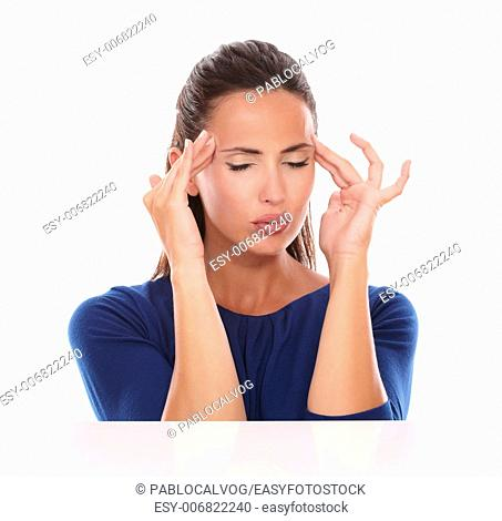 Lovely female with closed eyes suffering headache in white background