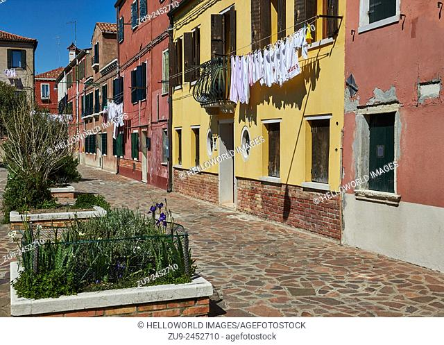 Row of houses and washing hanging out in picturesque Corte Bigaglia, Murano Island, Venetian Lagoon, Veneto, Italy, Europe