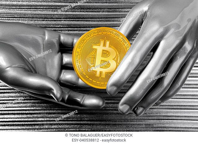 Bitcoin BTC cryptocurrency on silver futuristic hands