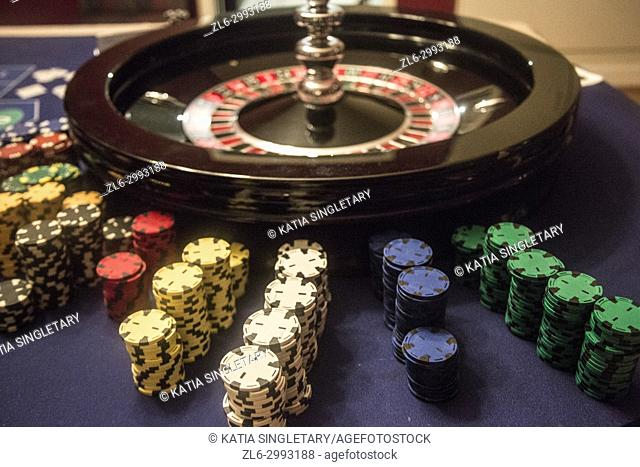 Playing roulette, Roulette game with money around the roulette. The chips of all different colors are lined up waiting to be bought
