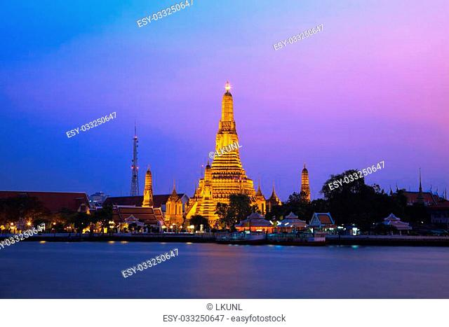 Wat Arun, The Temple of Dawn, at twilight, view across river. Bangkok, Thailand