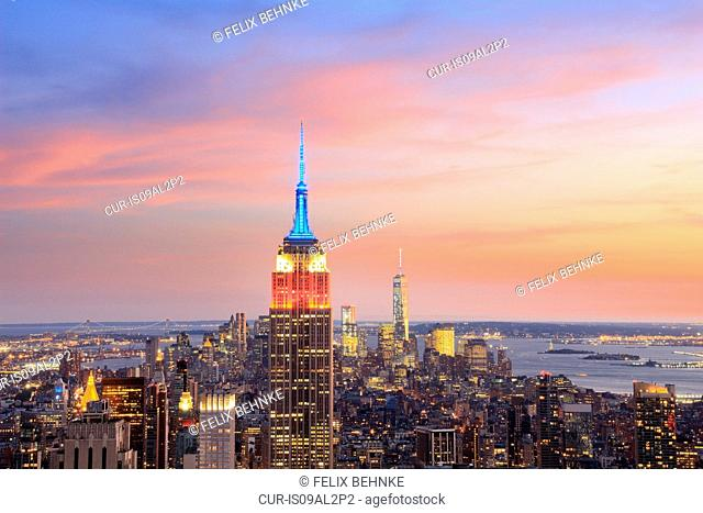 View of Manhattan skyline and Empire State building at dusk, New York, USA