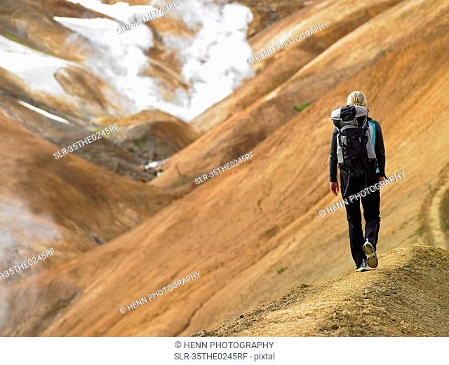Hikers walking on sandy mountainside
