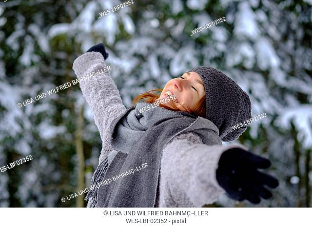 Happy teenage girl enjoying the winter