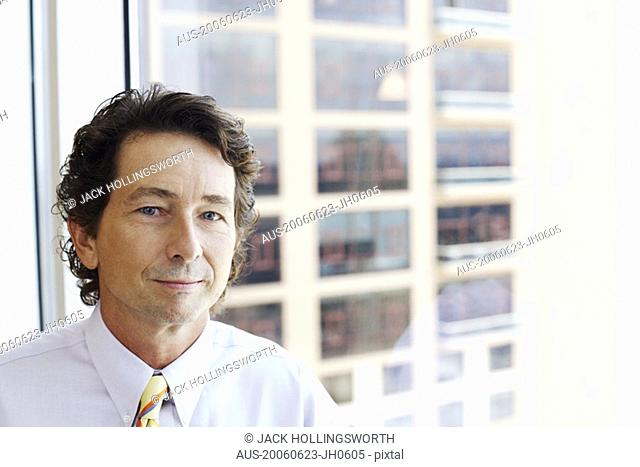 Portrait of a businessman smirking