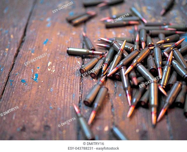 Bullets on a wooden surface. Ammo 5,45 mm