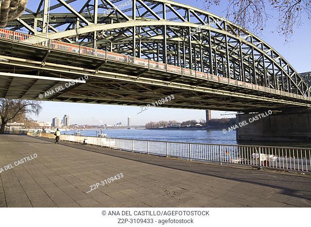 The Hohenzollern Bridge (German: Hohenzollernbrücke) is a bridge crossing the river Rhine in the German city of Cologne . Germany
