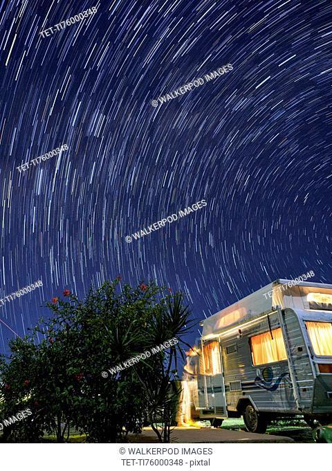 Australia, Queensland, Night sky over camper trailer
