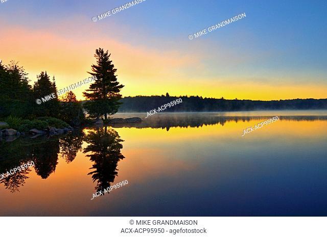 Reflection at dawn at Smoke Lake Algonquin Provincial Park Ontario Canada