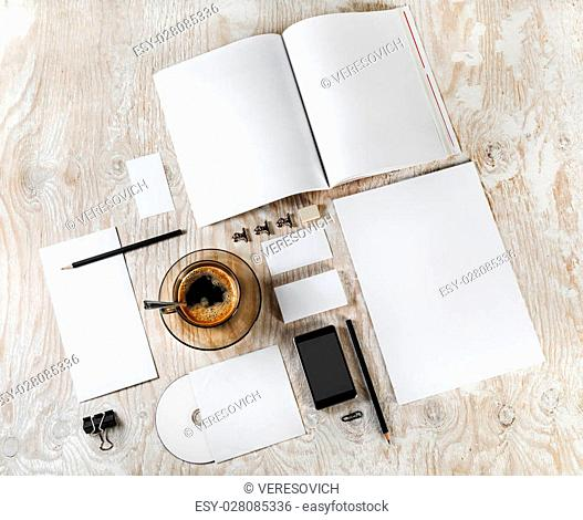 Photo of blank stationery. Blank corporate identity template on light wooden background. For design presentations and portfolios