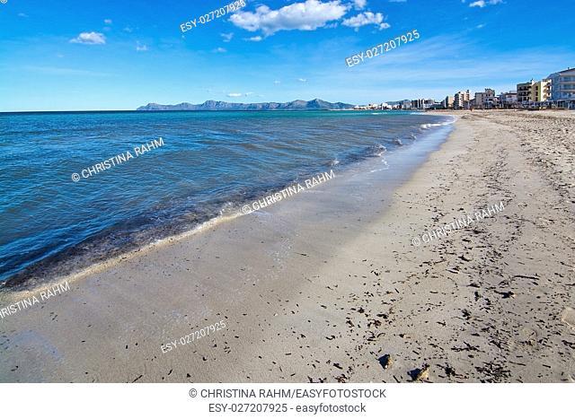 Empty sandy Mediterranean beach in spring sunshine in Majorca, Spain