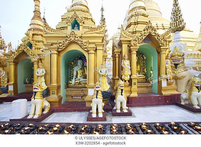 Lighted candles in the evening, Shwedagon pagoda, Yangon, Myanmar, Asia