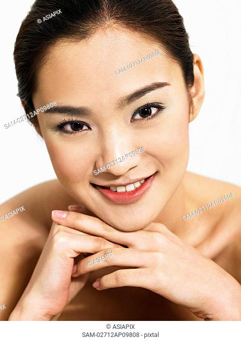 head shot of woman smiling at camera