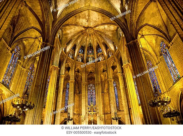 Stained Glass Windows Stone Columns Arches Altar Cross Gothic Catholic Barcelona Cathedral Basilica in Catalonia, Barcelona, Spain