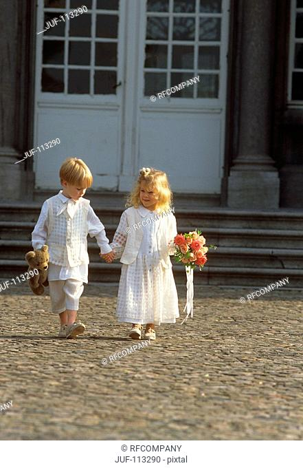 girl and boy in white clothes