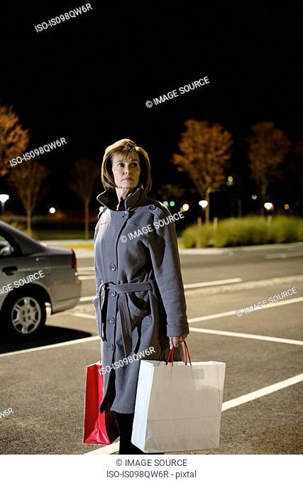 Woman alone in parking lot