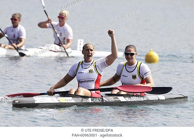 Sabrina Hering and Steffi Kreigerstein of Germany celebrate after winning gold in the women's kayak double 1000 m event during the ICF Canoe Sprint World...