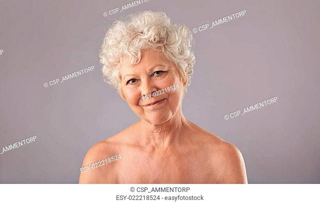 Attractive old woman looking happy