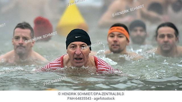 More than 60 New Year swimmers bathed at Heidesee lake in Halle/Saale, Germany, 6 January 2016. The bathers braved the air temperature of minus 6 degrees...