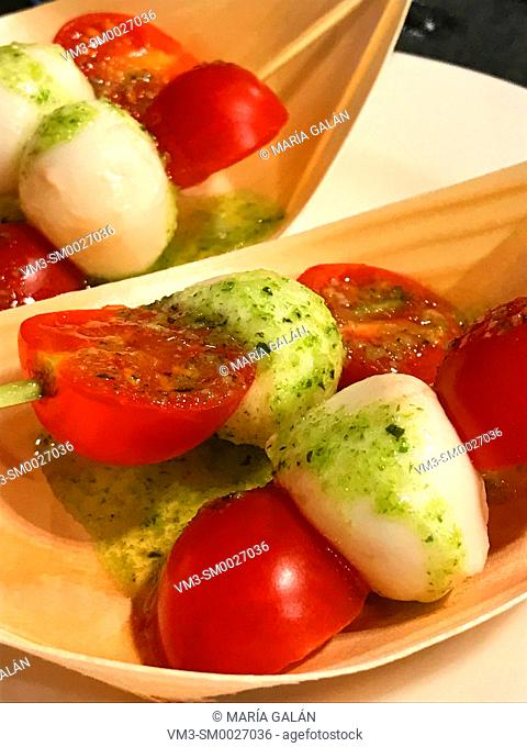 Cherry tomatoes with cottage cheese and parsley sauce