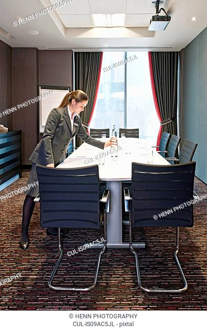 Woman preparing conference table