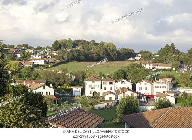 Espelette village in French Basque country, house walls are traditionally decorated with Red Pappers. Labourd, Atlantic Pyrenees, Aquitaine, France