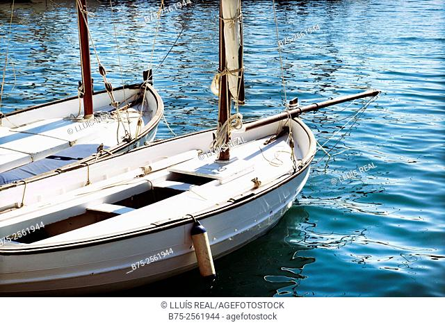 Wooden vintage boat Menorquin style with lateen sail, moored in the port of Mahon. Mahón, Menorca, Biosphere Reserve, Balearic Islands, Spain