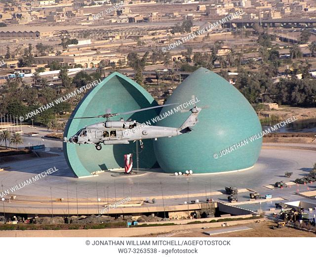 IRAQ Baghdad -- 30 Nov 2003 -- A helicopter assigned to the â. œFirehawksâ. . of Helicopter Combat Search and Rescue Squadron Five (HCS-5) flies over the...