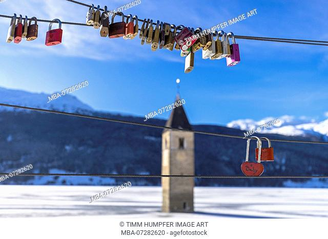 Europe, Italy, South Tyrol, Graun, Reschensee, love padlocks at the Reschensee in South Tyrol