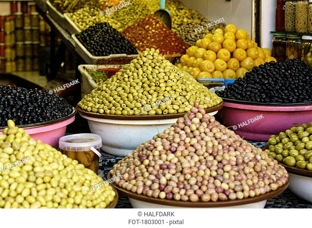 Abundant variety of fresh olives on display in souk market stall, Marrakesh, Morocco