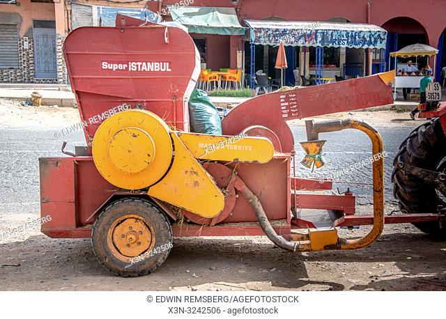 Red and yellow wood chipper in the city of Ouarzazate, Morocco