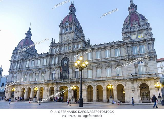 City hall at dusk, Plaza de Maria Pita square, Coruña city, Galicia, Spain