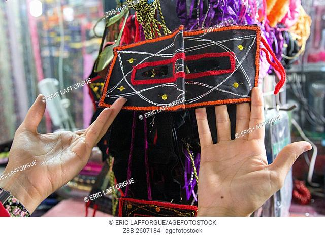 Iran, Hormozgan, Bandar Abbas, face mask sold in a shop in the bazaar