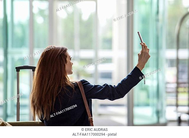 Businesswoman taking selfie with smart phone