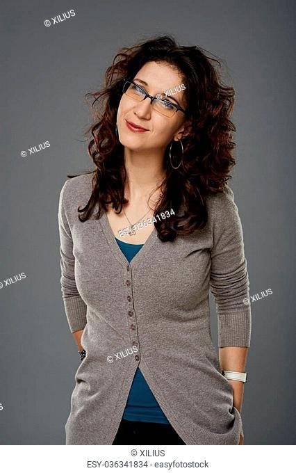 Studio portrait of a young woman wearing eyeglasses