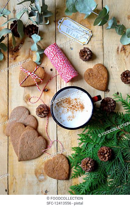 Christmas gingerbread and coffee mug on a wooden table