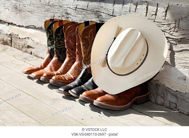 USA, Illinois, Metamora, Row of cowboy boots and cowboy hat