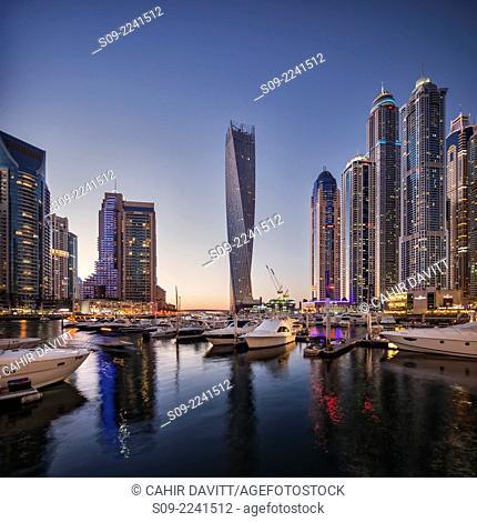 Dubai Marina at twilight with the Cayan Tower (Infinity Tower), the Dubai Marriott Harbour Hotel and Suites and various residential towers, Dubai Marina, Dubai