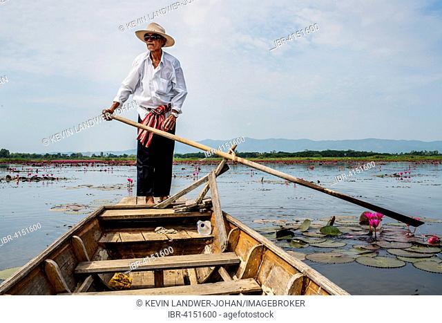 Boatman on the lake, near Phayao, Thailand