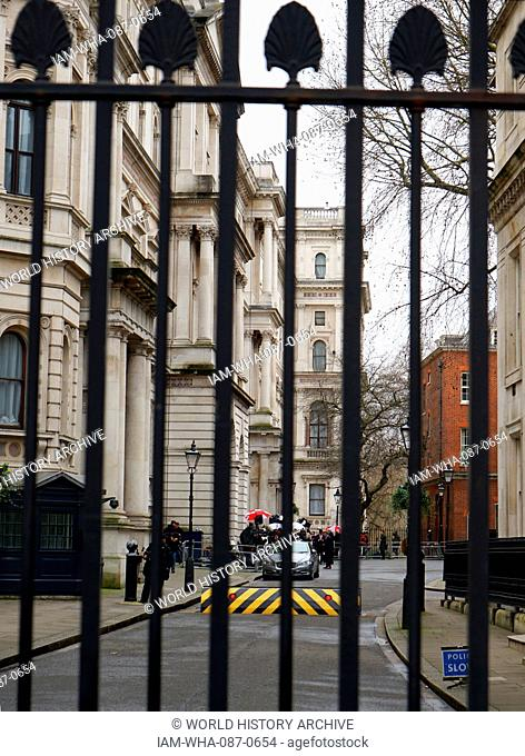 Security gates with raised road ramp at the entrance to Downing Street London. Downing Street is the home to the Chancellor of the Exchequer and the British...