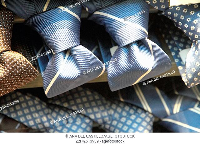 Display of different patterns and colours of man ties in a shop or showroom Milan Italy